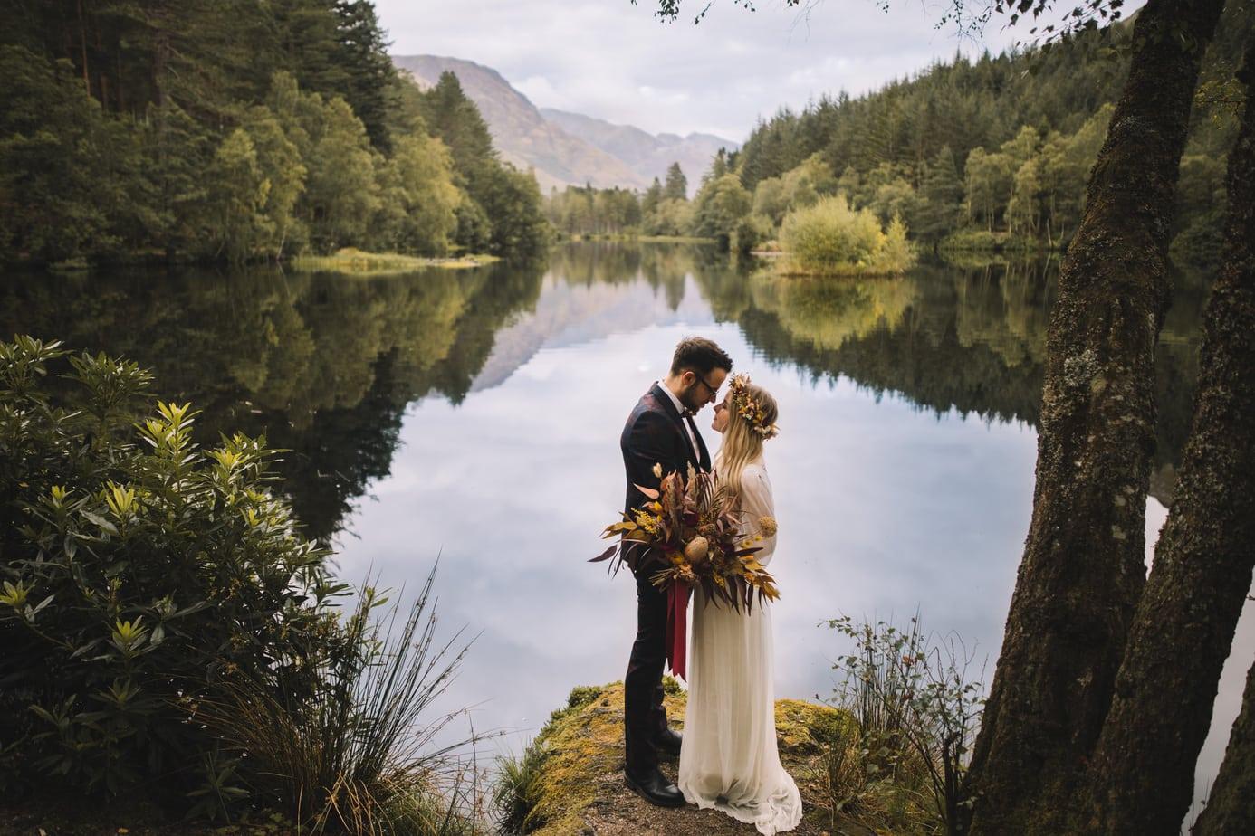Scotland Elopement. Couple eloping at Glencoe Lochan, bride wearing a dried flower crown