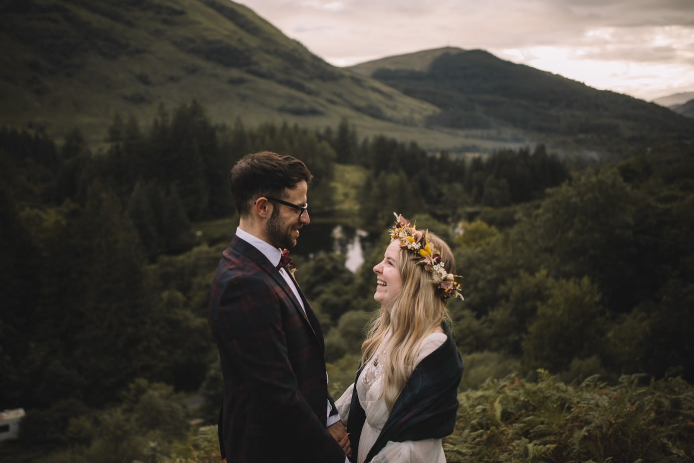 Scotland elopement. Couple laughing together at the site of Hadgrids hut