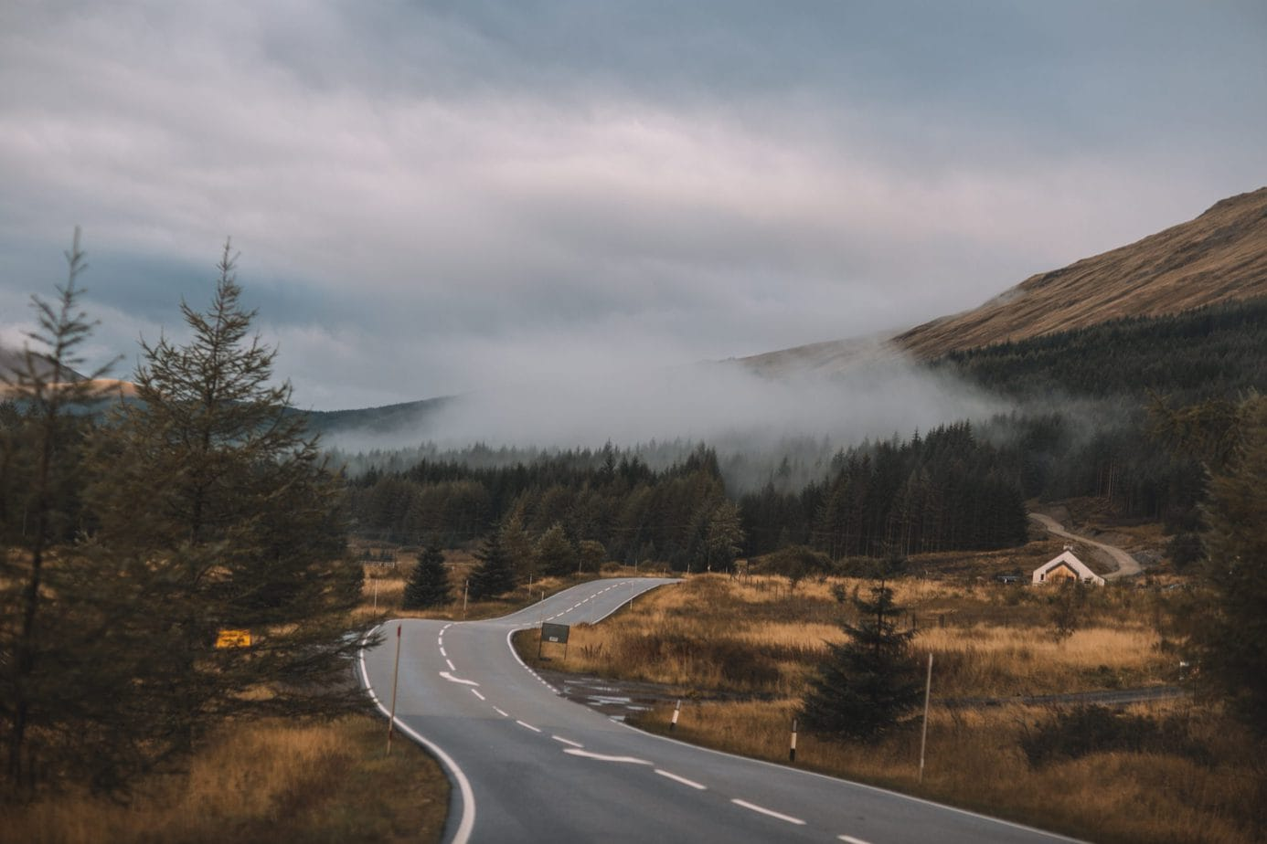 Pretty road with forest on the way to a Scotland elopement