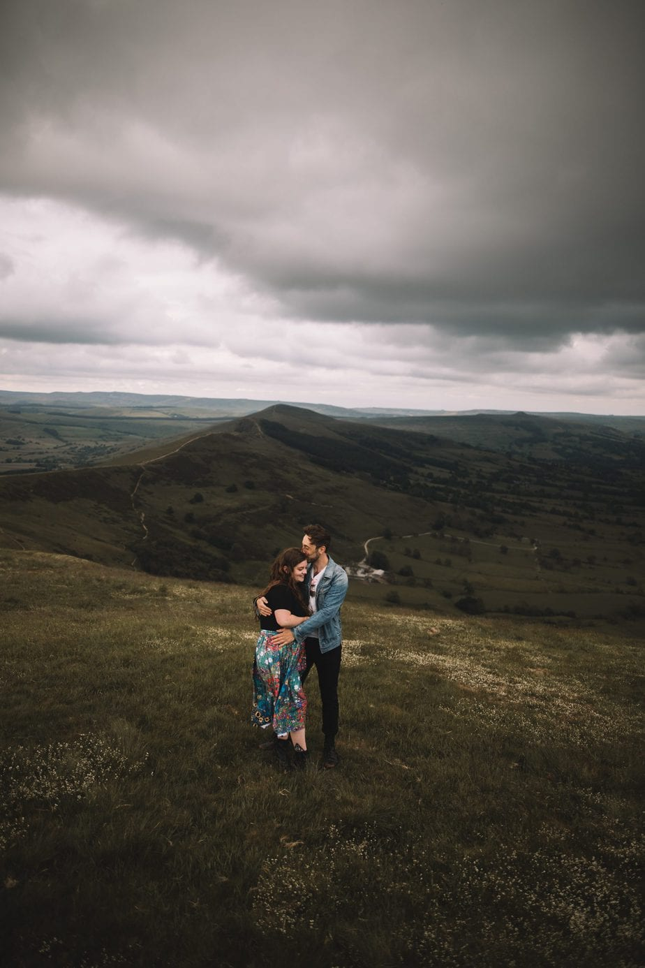 Peak District engagement shoot, couple cuddling on mam tor